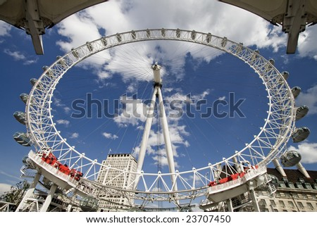 londoneye photographed from a near harbor, london - stock photo