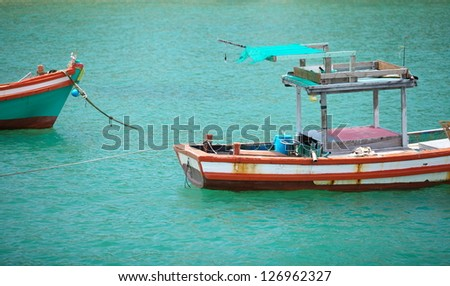 Lone Boat on tropical paradise - stock photo