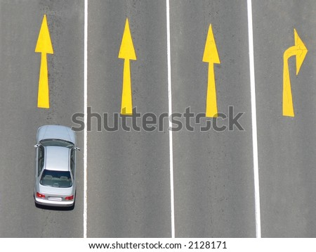Lone car in four lanes from above. - stock photo