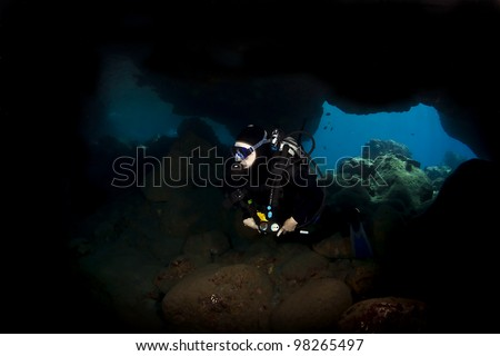 Lone Diver exploring a Lava Tube in Kona Hawaii - stock photo