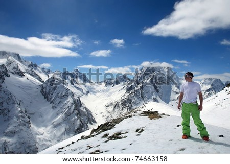 Lone man in a beautiful mountain landscape of the Caucasus Mountains Dombai - stock photo