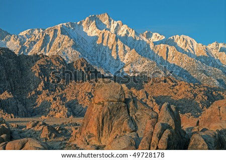 Lone Pine Peak and Alabama Hills at sunrise Eastern Sierra Nevada Mountains, California, USA - stock photo
