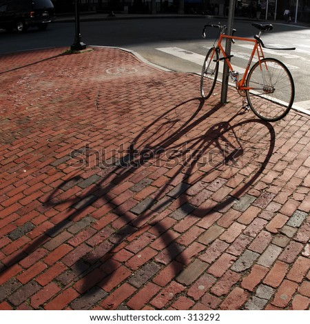 Lonely bike standing on a street - stock photo
