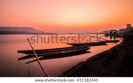 Lonely boat and amazing sunset at the sea - stock photo