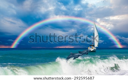 lonely boat and dolphin against rainbow - stock photo