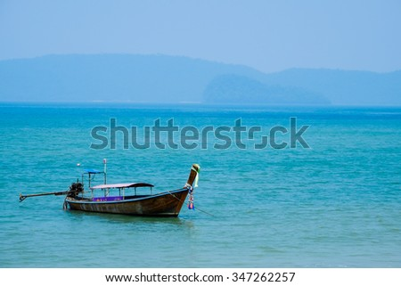 Lonely boat in the sea - stock photo