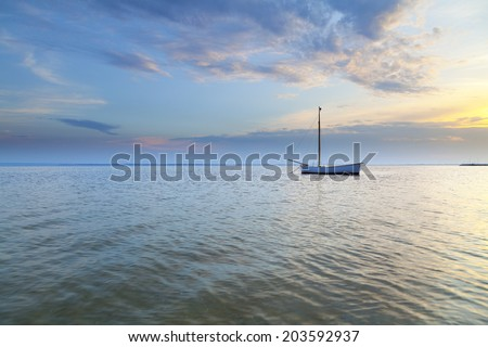 Lonely boat moored in the Bay of Puck - Poland - stock photo