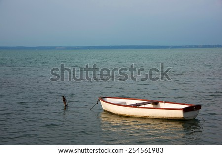 Lonely boat on Balaton lake, Hungary - stock photo