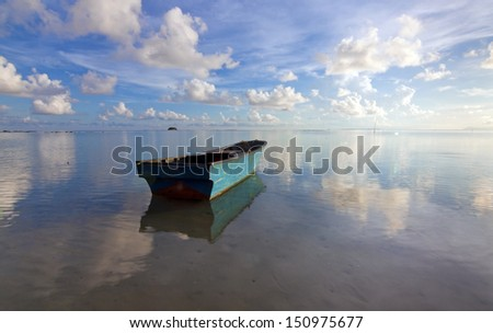 Lonely boat with blue sky at Sabah, Borneo, Malaysia - stock photo