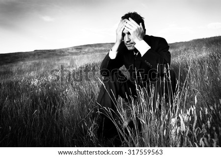 Lonely Businessman Depressed Life Stress Concept - stock photo