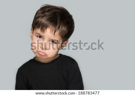 Lonely child unhappy and upset - stock photo