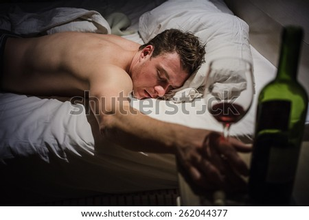Lonely Drunk Man Sleeping After a Bottle of Wine. - stock photo