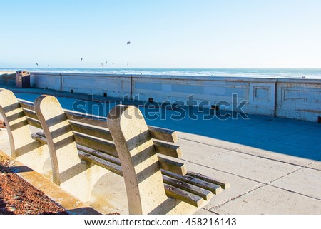Lonely empty bench pointing at the amazing Pacific ocean beach view in San Francisco, California. - stock photo