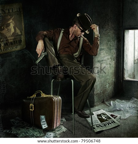 Lonely gangster with gun and suitcase full of money. Art-photo in original style - stock photo