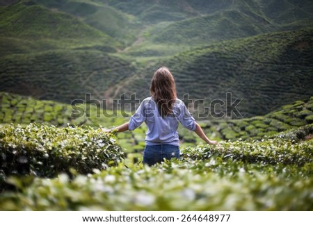 lonely girl in mountains    - stock photo