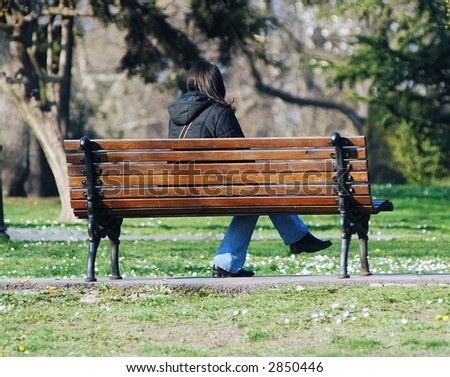 Lonely girl in park - stock photo