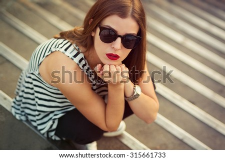 Lonely girl on the stairs. Toned image - stock photo