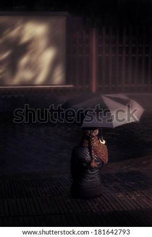 lonely glonely girl with an umbrella in a personal cinema - stock photo