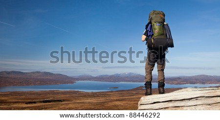 Lonely hiker in the wilderness of Norway in autumn - stock photo