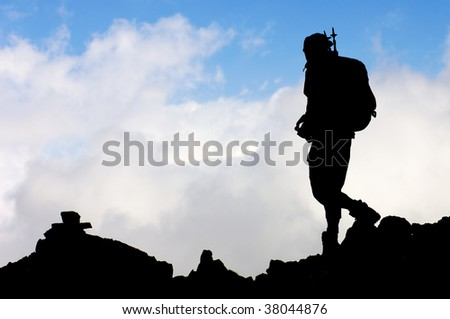 Lonely hiker with blue sky - stock photo