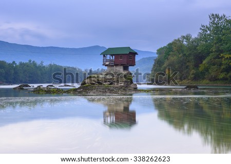 Lonely house on the river Drina in Bajina Basta, Serbia - stock photo