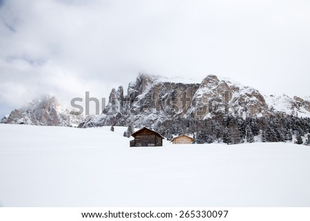 Lonely houses in the mountains / Lonely houses in the mountains on Seiser Alm, South Tyrol, Italy. - stock photo