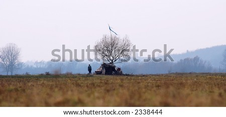Lonely man and naked tree in late november - stock photo