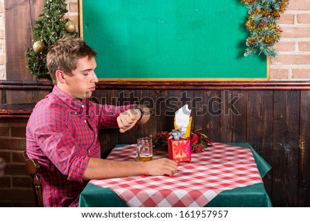 Lonely Man at Restaurant Waiting for the Girlfriend - stock photo