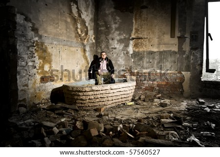 lonely man in industrial place - stock photo