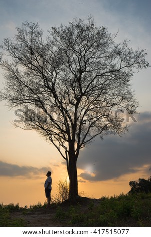 Lonely Man on background sunset , love story. - stock photo