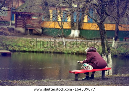 lonely man on the bench autumn, winter - stock photo
