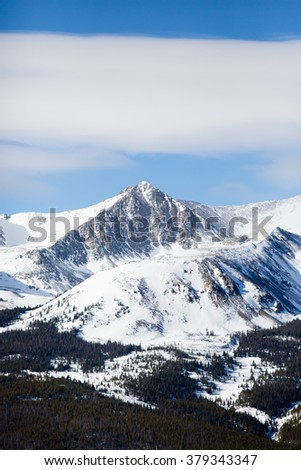 Lonely Mountain - This is an image of a beautiful snow covered mountain peak in Colorado. - stock photo