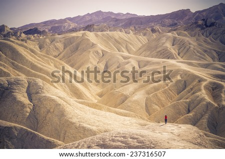 Lonely person at Zabriskie Point in Death Valley National Park, California - stock photo