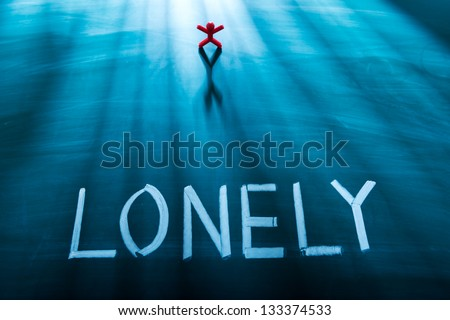 Lonely person concept, conceptual word on blackboard - stock photo