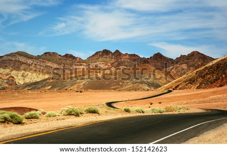 Lonely Road Through Mountains in Death Valley National Park, California, USA - stock photo