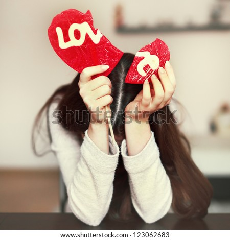 Lonely sad girl with broken heart - stock photo
