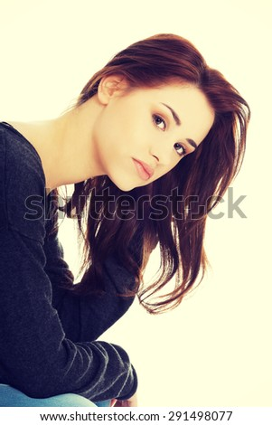Lonely sad woman deep in thoughts - stock photo