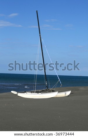 Lonely sail Boat on the Beach - stock photo