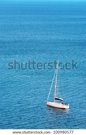 lonely sailboat off the coast of algarve, portugal - stock photo