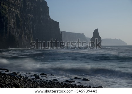 Lonely sea stack seen from the bottom of Cliffs of Moher - stock photo