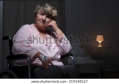 Lonely senior woman staying in rest home - stock photo