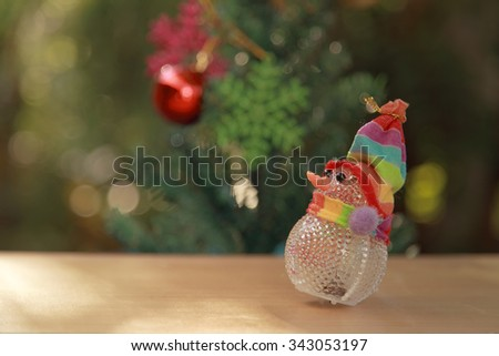 lonely snowman with light blur background for Christmas holidays - stock photo