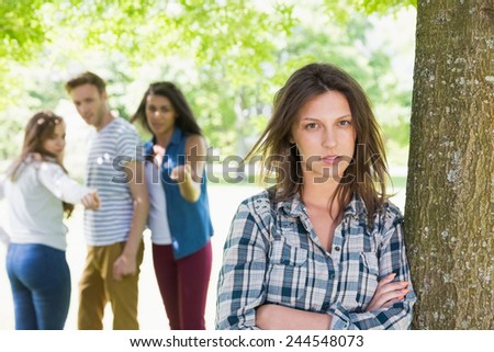 Lonely student being bullied by her peers at the university - stock photo