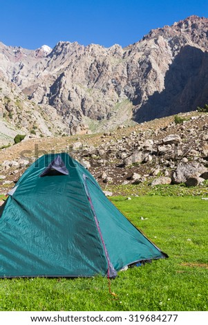 Lonely tent in Fan Mountains, Tajikistan, Central Asia - stock photo