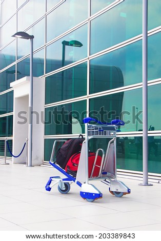 lonely trolley at the airport - stock photo