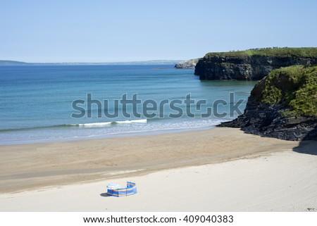 lonely wind breaker on the sandy beach in ballybunion county kerry ireland - stock photo
