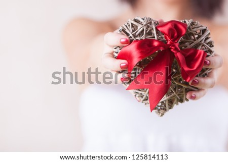Lonely woman giving her heart - stock photo