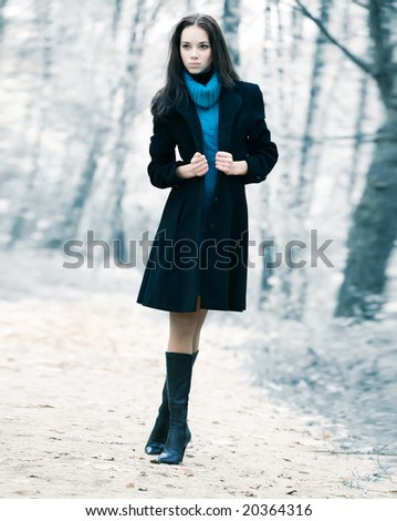 Lonely woman in a forest. Infra red colors. - stock photo