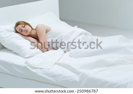 lonely woman in bed  overhead view of sleeping beauty - stock photo