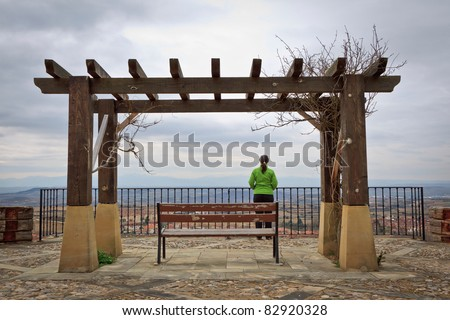 Lonely woman looking at the landscape, Labastida, Alava, Spain - stock photo